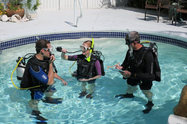 NAUI Instructor (left) evaluates his FIT  candidate's ability to demonstrate sharing air.