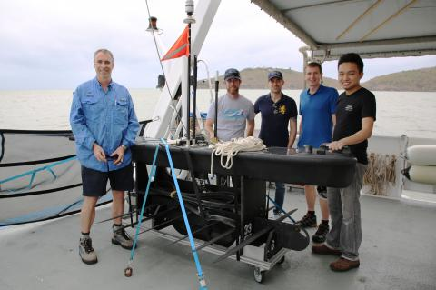 The Wave Glider, with (from left) Scott Bainbridge (AIMS), Daniel Merritt (Liquid Robotics), Ricardo Puig (Liquid Robotics), Michael de La Chapelle (Boeing) and Shahmi Suhaimee (Liquid Robotics).