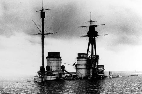 Scuttling of the German Fleet at Scapa Flow—the upper-works of the German battle-cruiser SMS Hindenburg above the water at Scapa Flow.