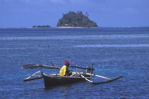 Fisherman on bangka, Northern Sulawesi, Indonesia.